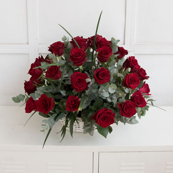 50 red roses composition in white basket