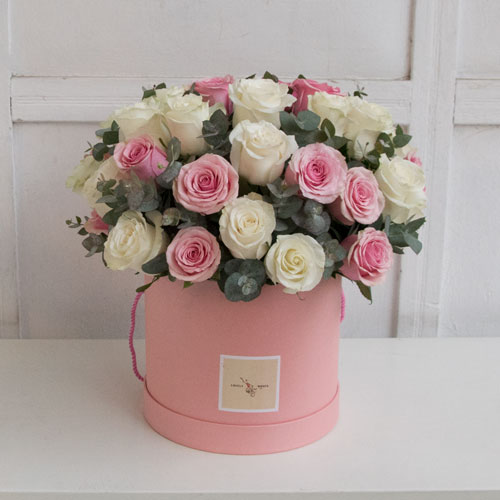 Pink and white roses in a pink box