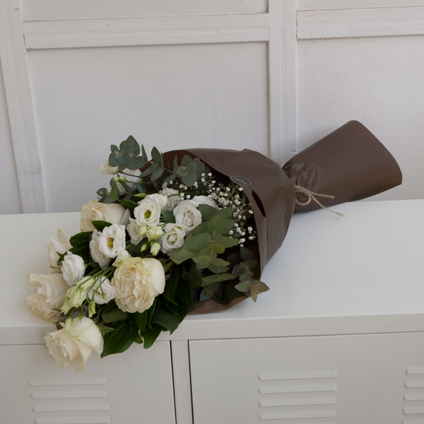 Funeral bouquet with white roses