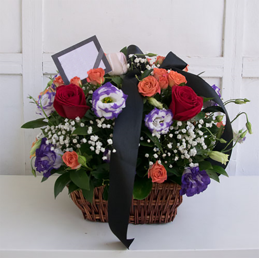 Funeral basket with different flowers
