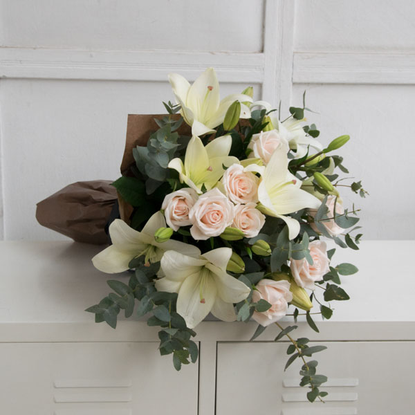 Bouquet with white lilies and roses