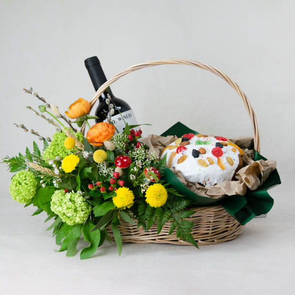 Easter basket with cake and wine