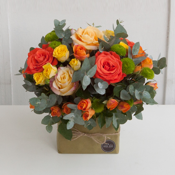Roses arrangement in yellow and orange