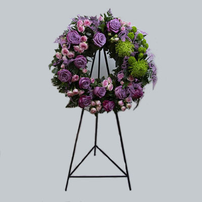Funeral wreath with purple roses