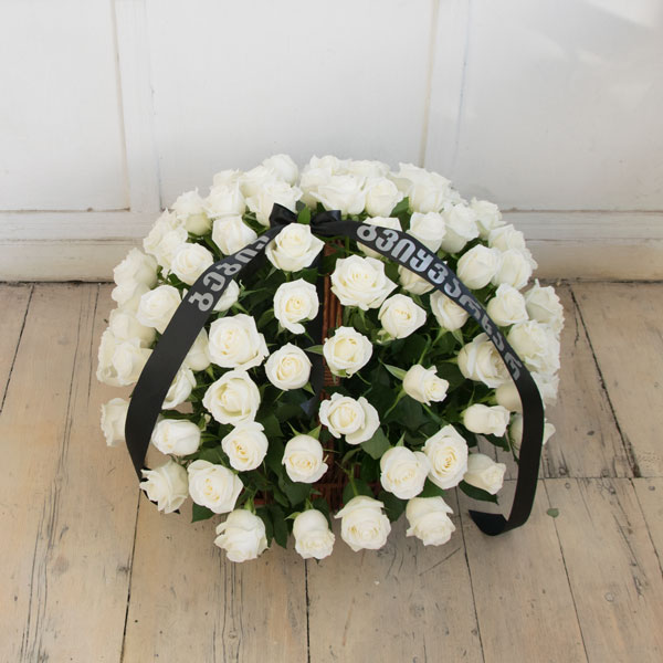 Funeral basket with white roses