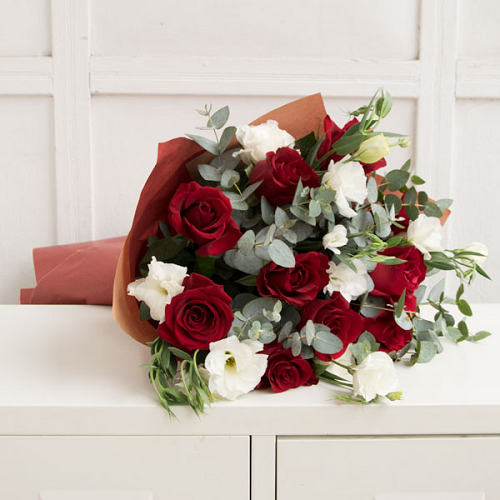 Bouquet of red roses with white eustoma