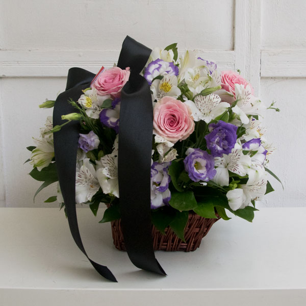 Funeral basket with pink roses
