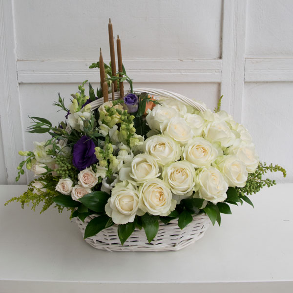 White roses composition in white basket